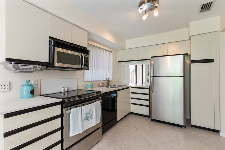 Real Estate Photography - 833 Reef Point Circle, Naples, FL, 34108 - Kitchen