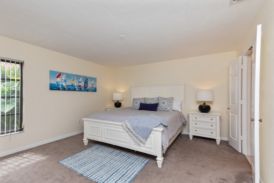 Real Estate Photography - 833 Reef Point Circle, Naples, FL, 34108 - Master Bedroom