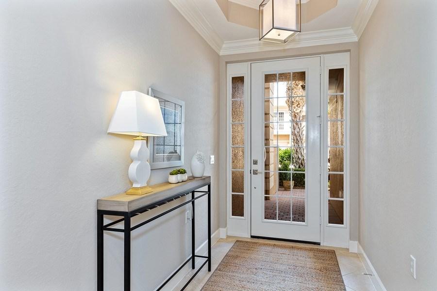 Real Estate Photography - 23751 Merano Ct, Unit 101, Bonita Springs, FL, 34134 - Foyer