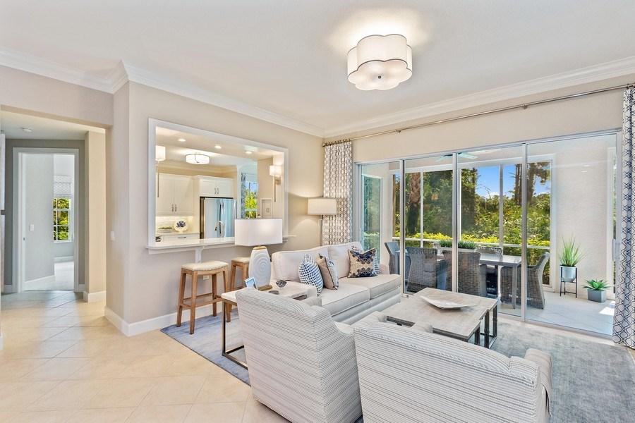 Real Estate Photography - 23751 Merano Ct, Unit 101, Bonita Springs, FL, 34134 - Kitchen / Living Room