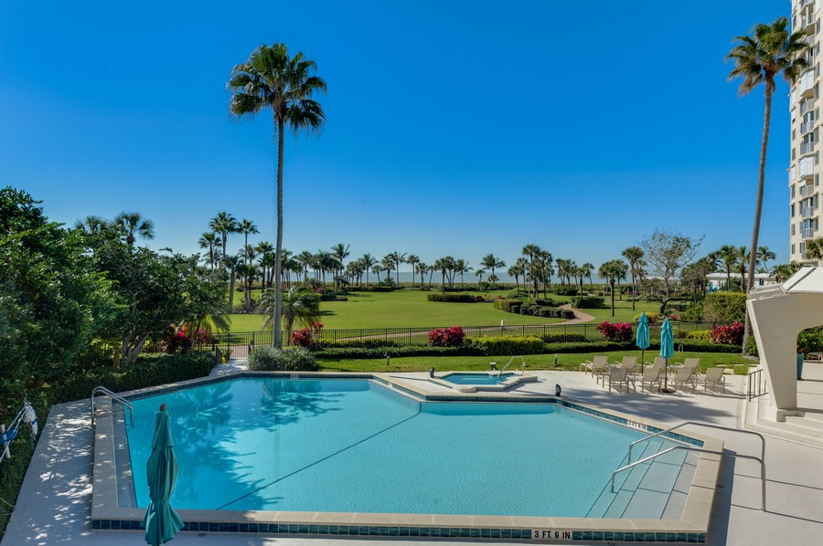 Real Estate Photography - 4031 Gulf Shore Blvd, N PH2D, Naples, FL, 34103 - Gulf View from Pool