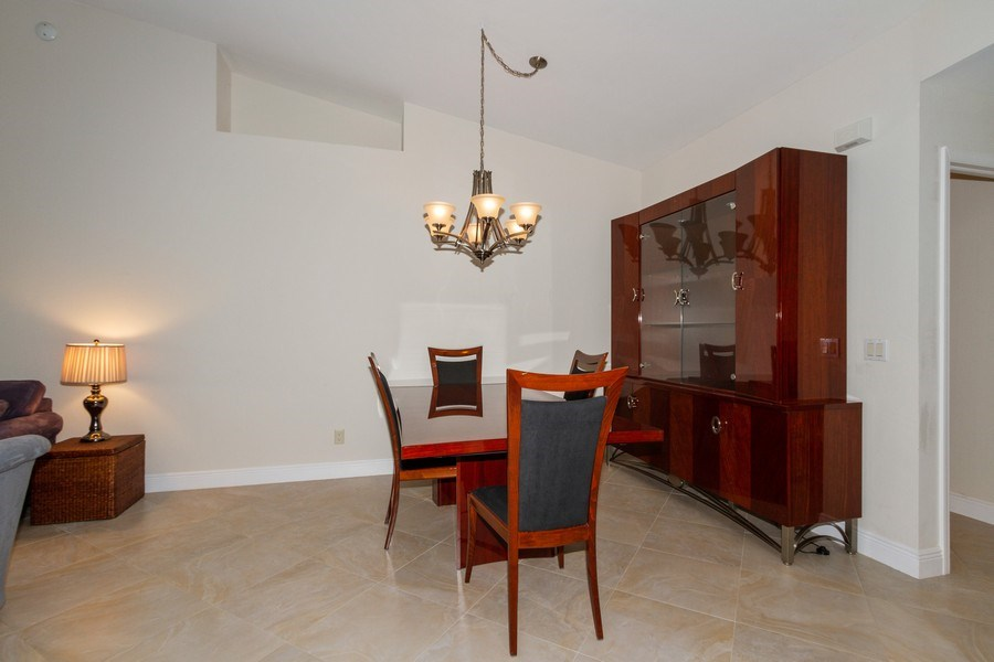 Real Estate Photography - 5637 Whisperwood Blvd #603, Naples, FL, 34110 - Dining Room