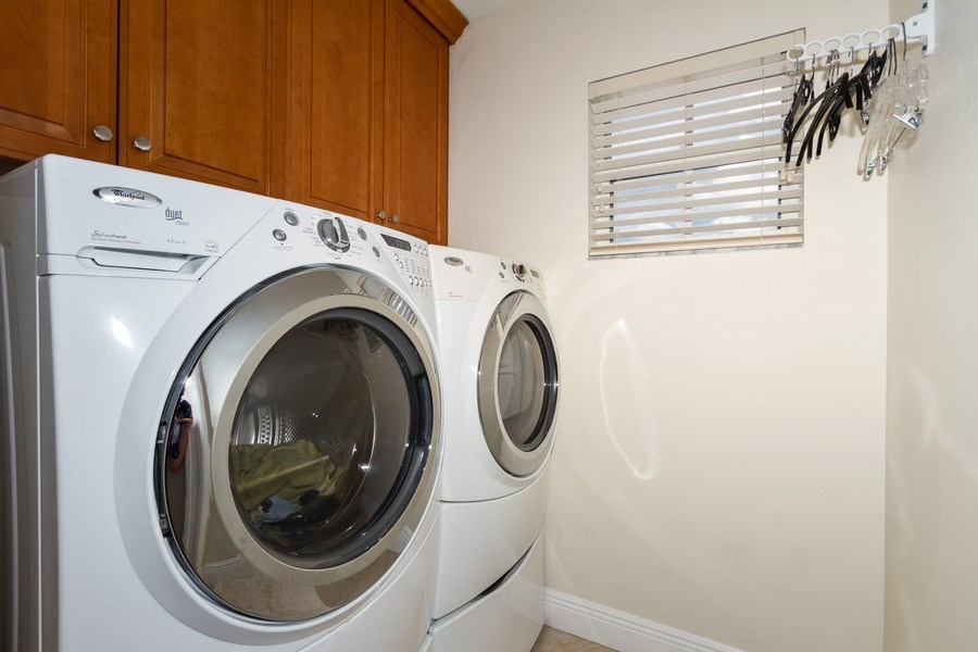 Real Estate Photography - 5637 Whisperwood Blvd #603, Naples, FL, 34110 - Laundry Room