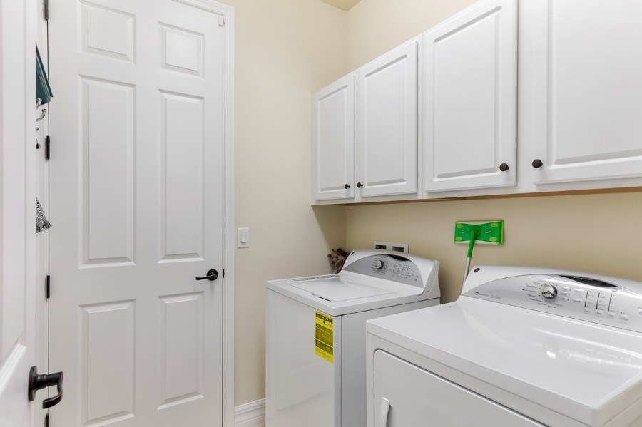 Real Estate Photography - 28537 Westmeath ct, Bonita Springs, FL, 34235 - Laundry Room