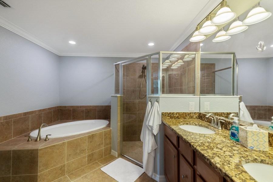 Real Estate Photography - 28021 Cookstown Ct, Unit 3601, Bonita Springs, FL, 34135 - Master Bathroom
