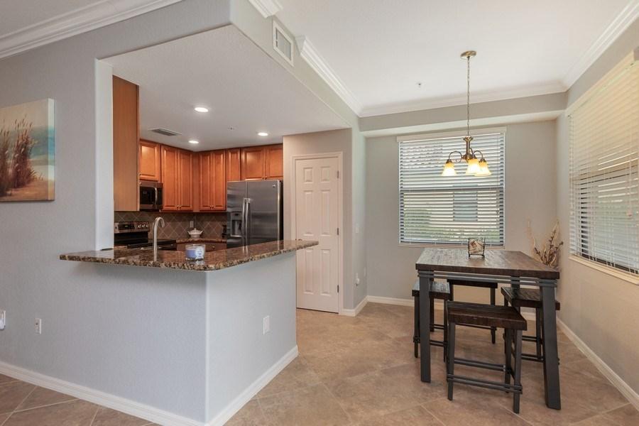 Real Estate Photography - 28021 Cookstown Ct, Unit 3601, Bonita Springs, FL, 34135 - Kitchen