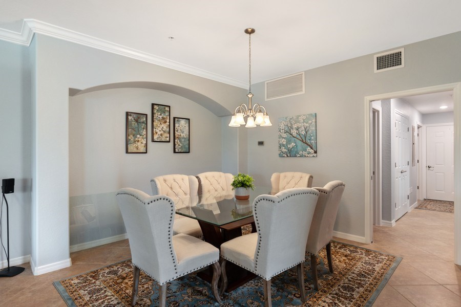 Real Estate Photography - 28021 Cookstown Ct, Unit 3601, Bonita Springs, FL, 34135 - Dining Room