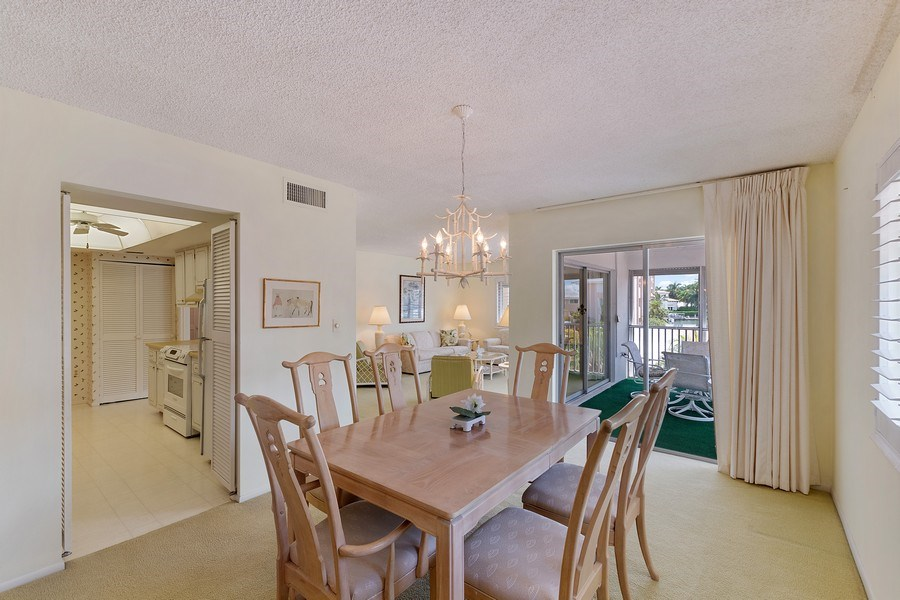 Real Estate Photography - 1930 Gulf Shore Blvd N, B201, Naples, FL, 34102 - Dining Area 2