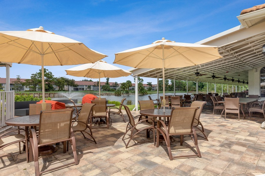 Real Estate Photography - 216 Glen Eagle Circle, Naples, FL, 34104 - Clubhouse