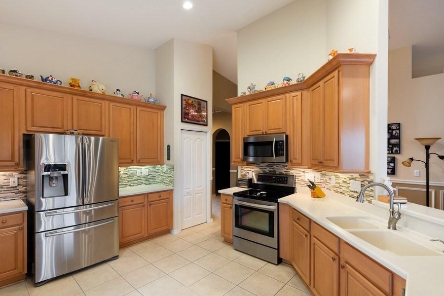 Real Estate Photography - 216 Glen Eagle Circle, Naples, FL, 34104 - Kitchen