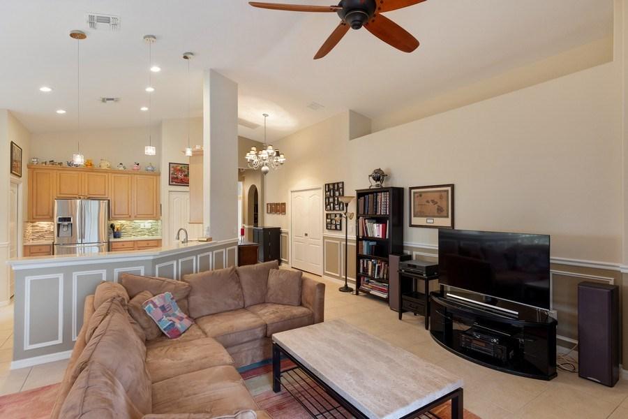 Real Estate Photography - 216 Glen Eagle Circle, Naples, FL, 34104 - Kitchen/Living
