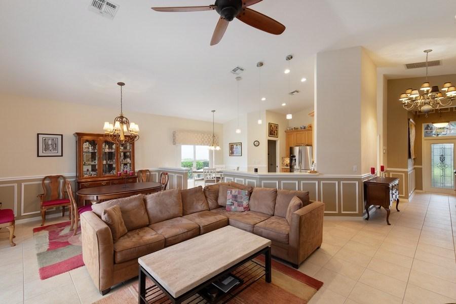 Real Estate Photography - 216 Glen Eagle Circle, Naples, FL, 34104 - Living Room/Dining Room