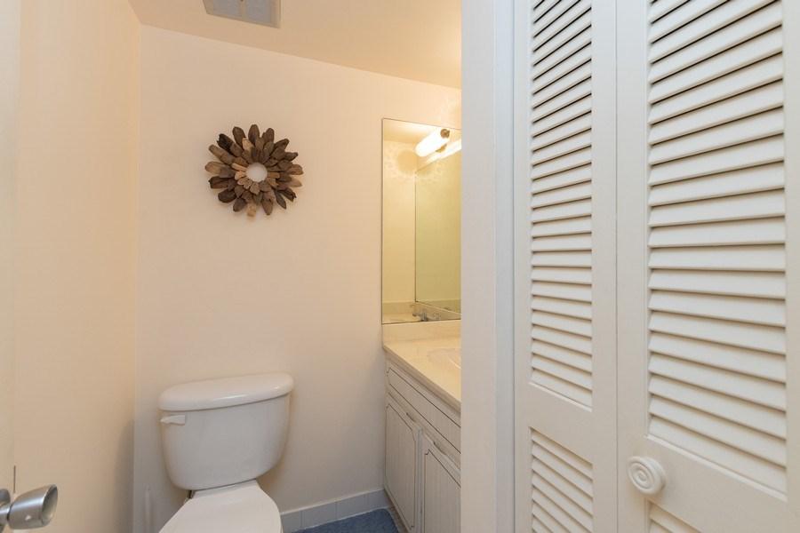Real Estate Photography - 3410 Gulf Shore Blvd N, 202, Naples, FL, 34103 - Powder Room