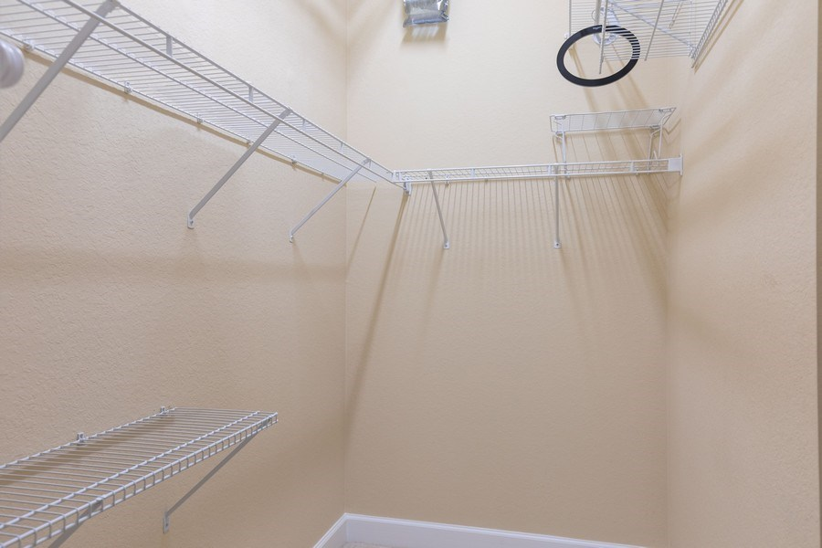 Real Estate Photography - 5892 Northridge Dr, Naples, FL, 34110 - Closet