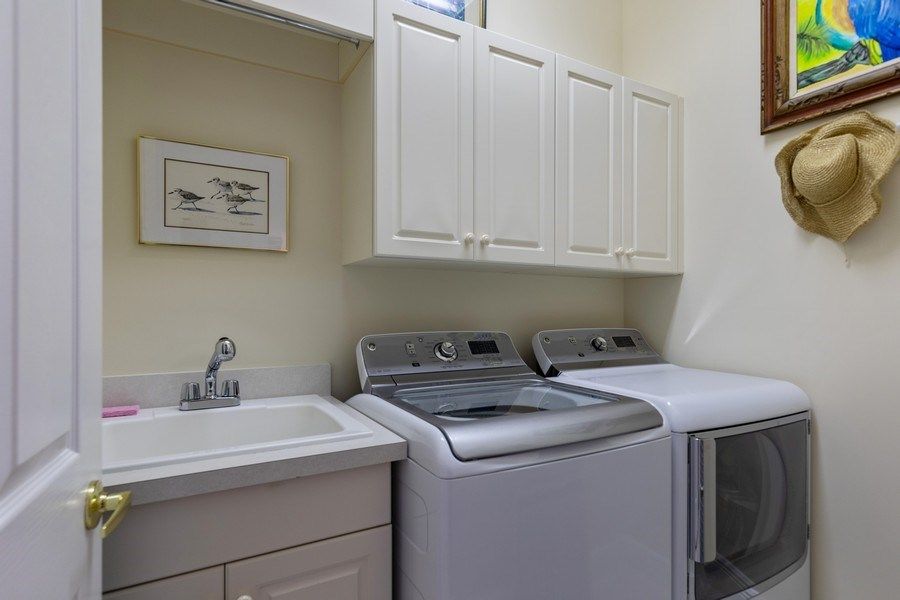 Real Estate Photography - 18240 Parkside Greens Drive, Ft Myers, FL, 33908 - Laundry Room