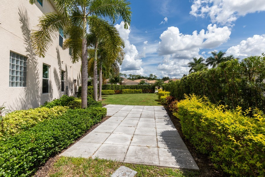 Real Estate Photography - 7786 Martino Circle, Naples, FL, 34112 - Side Yard