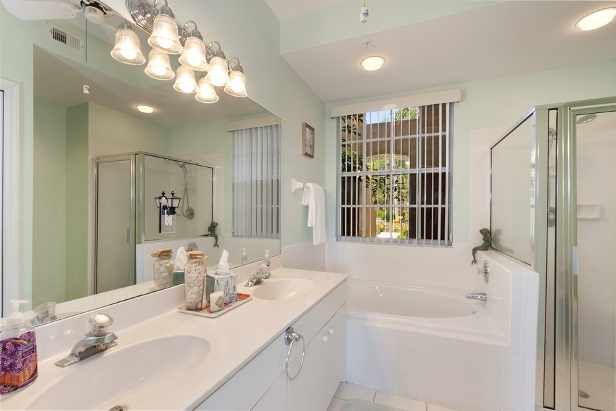 Real Estate Photography - 24796 Lakemont Cove Ln, 101, Bonita Springs, FL, 34134 - Master Bathroom