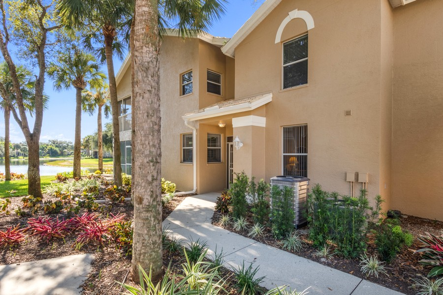 Real Estate Photography - 24796 Lakemont Cove Ln, 101, Bonita Springs, FL, 34134 - Entrance