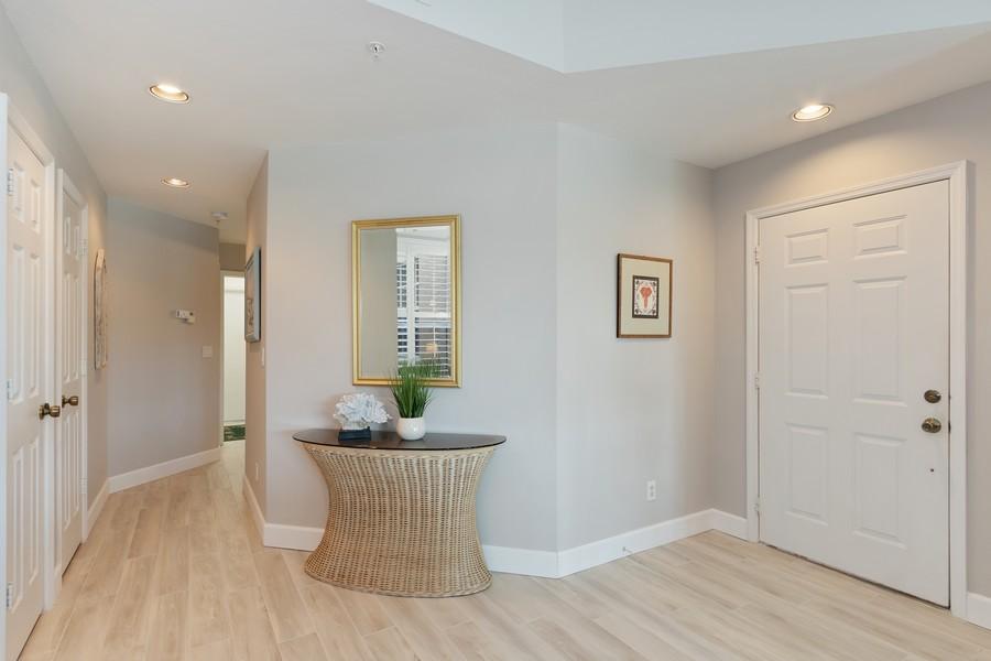 Real Estate Photography - 24796 Lakemont Cove Ln, 101, Bonita Springs, FL, 34134 - Foyer