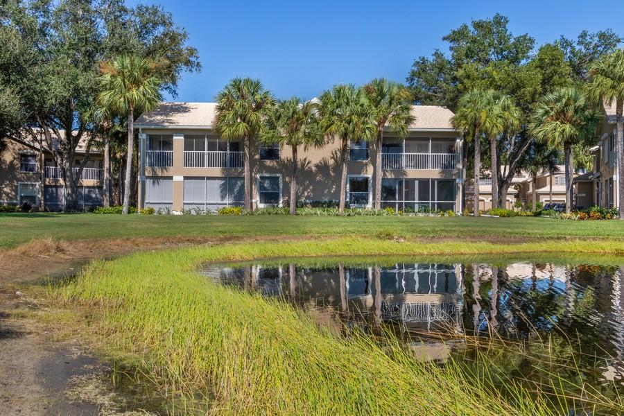Real Estate Photography - 24796 Lakemont Cove Ln, 101, Bonita Springs, FL, 34134 - Rear View