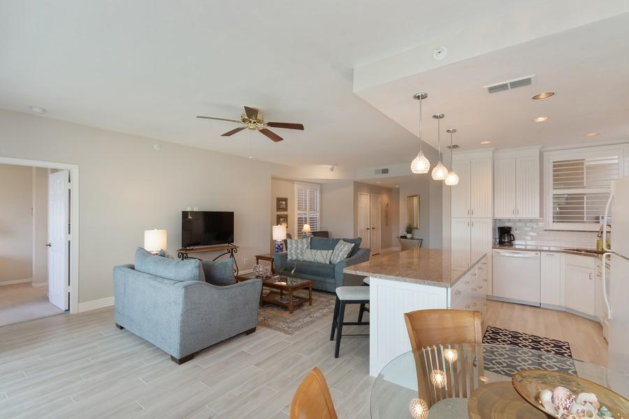 Real Estate Photography - 24796 Lakemont Cove Ln, 101, Bonita Springs, FL, 34134 - Kitchen / Living Room