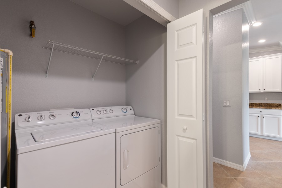 Real Estate Photography - 17980 Bonita National Blvd #1922, Bonita Springs, FL, 34135 - Laundry Room