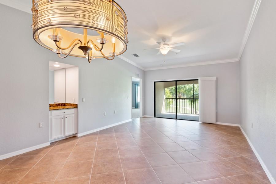 Real Estate Photography - 17980 Bonita National Blvd #1922, Bonita Springs, FL, 34135 - Dining Room/Living Room