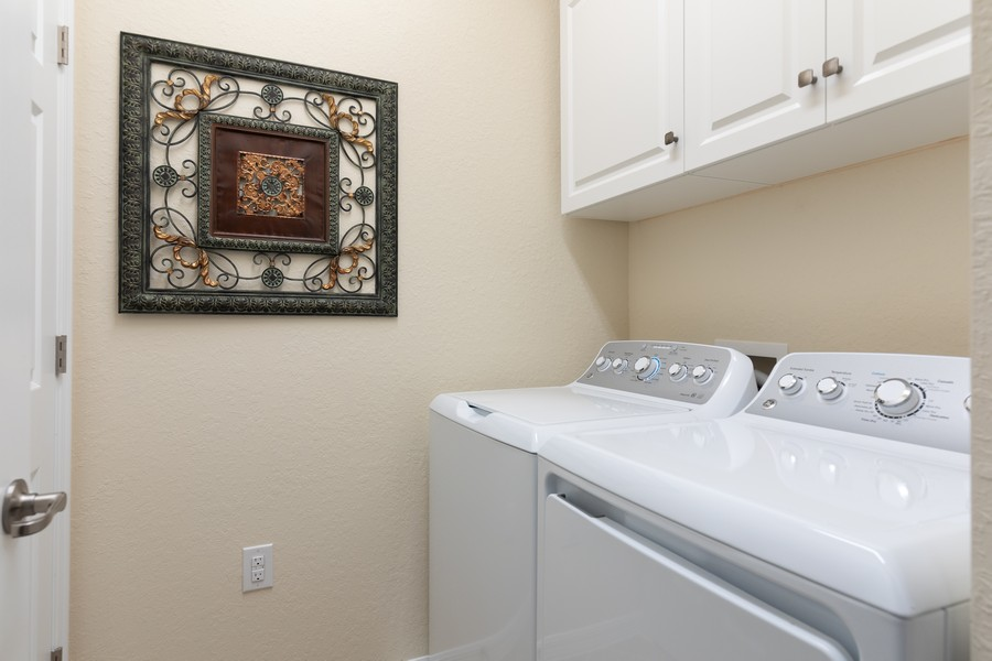 Real Estate Photography - 28005 Cookstown Ct, Unit 3403, Bonita Springs, FL, 34135 - Laundry Room