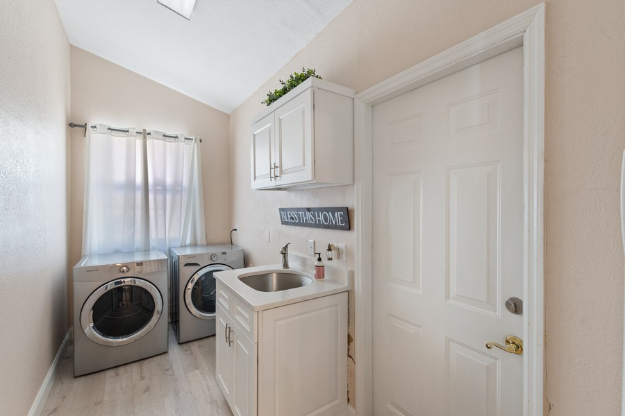 Real Estate Photography - 6061 Waxmyrtle Way, Naples, FL, 34109 - Laundry Room