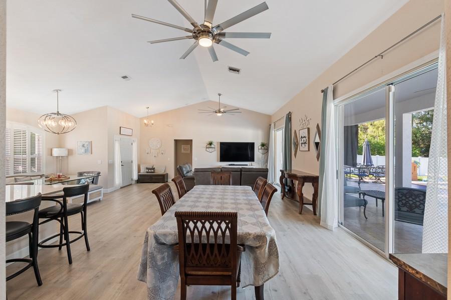 Real Estate Photography - 6061 Waxmyrtle Way, Naples, FL, 34109 - Living Room / Dining Room