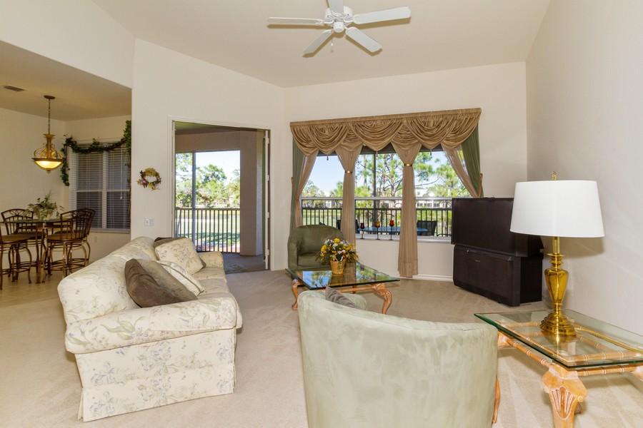 Real Estate Photography - 8447 Radcliffe Ter, Unit 203, Naples, FL, 34120 - Living Room