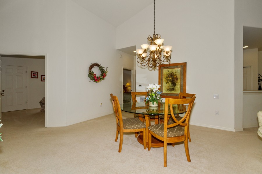 Real Estate Photography - 8447 Radcliffe Ter, Unit 203, Naples, FL, 34120 - Dining Room