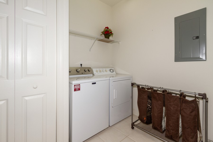 Real Estate Photography - 8447 Radcliffe Ter, Unit 203, Naples, FL, 34120 - Laundry Room