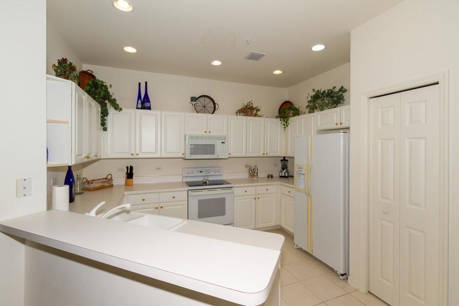 Real Estate Photography - 8447 Radcliffe Ter, Unit 203, Naples, FL, 34120 - Kitchen