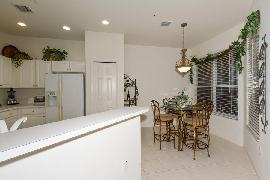 Real Estate Photography - 8447 Radcliffe Ter, Unit 203, Naples, FL, 34120 - Breakfast Nook