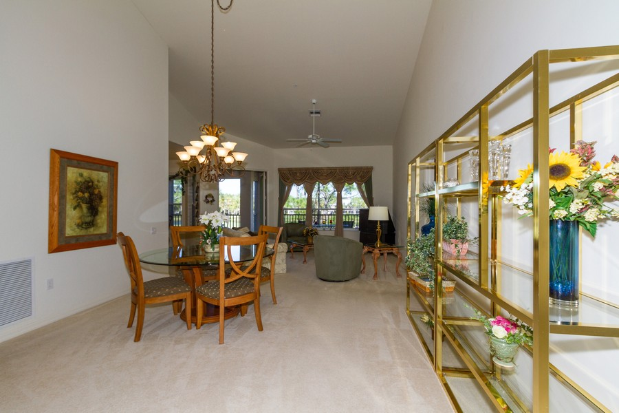 Real Estate Photography - 8447 Radcliffe Ter, Unit 203, Naples, FL, 34120 - Living Room / Dining Room