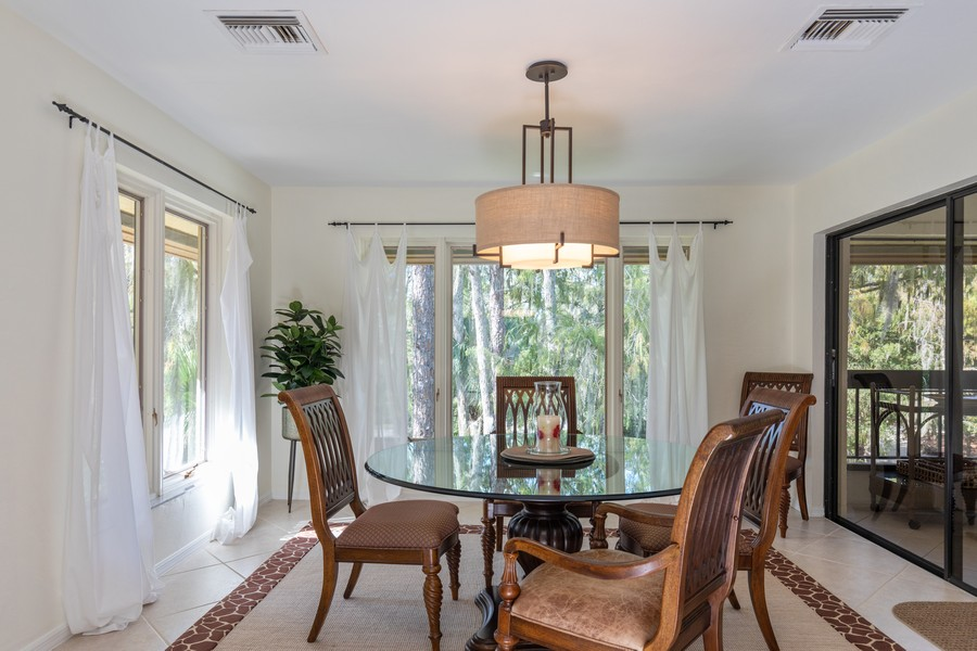 Real Estate Photography - 100 Wyndemere Way 301, Naples, FL, 34105 - Dining Room