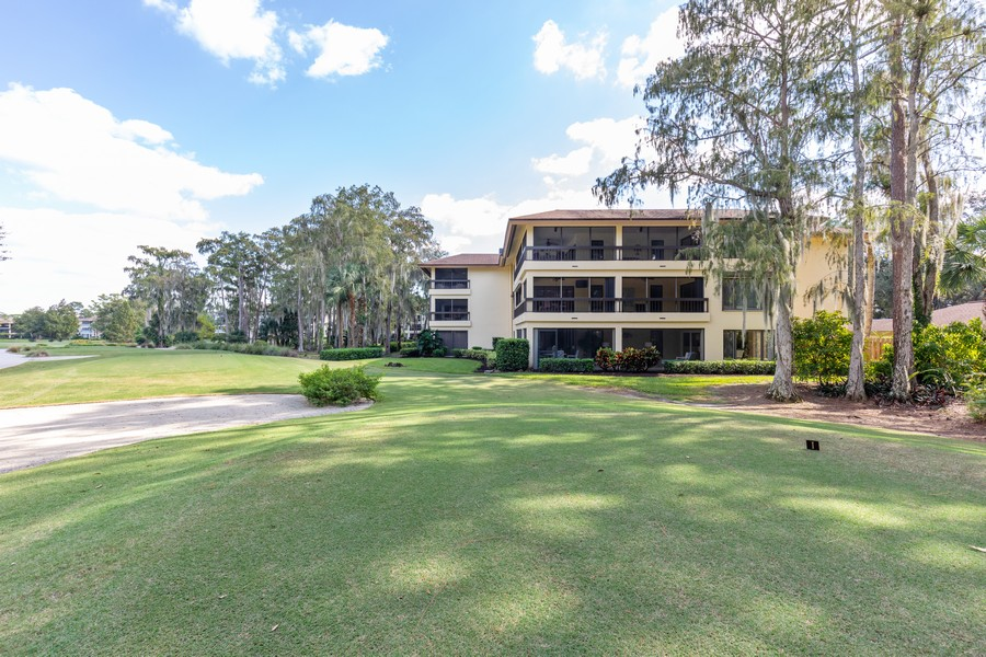 Real Estate Photography - 100 Wyndemere Way 301, Naples, FL, 34105 - Side View