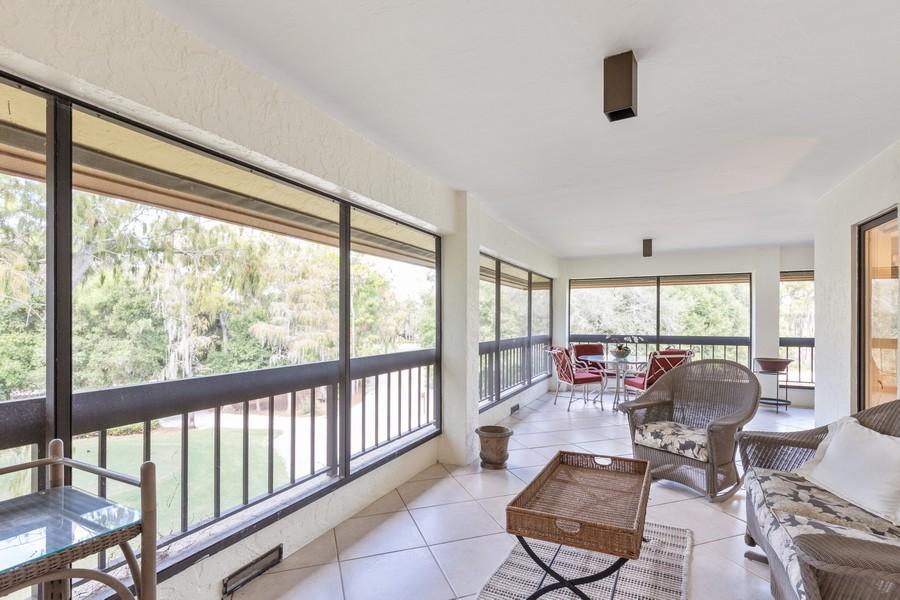 Real Estate Photography - 100 Wyndemere Way 301, Naples, FL, 34105 - Lanai