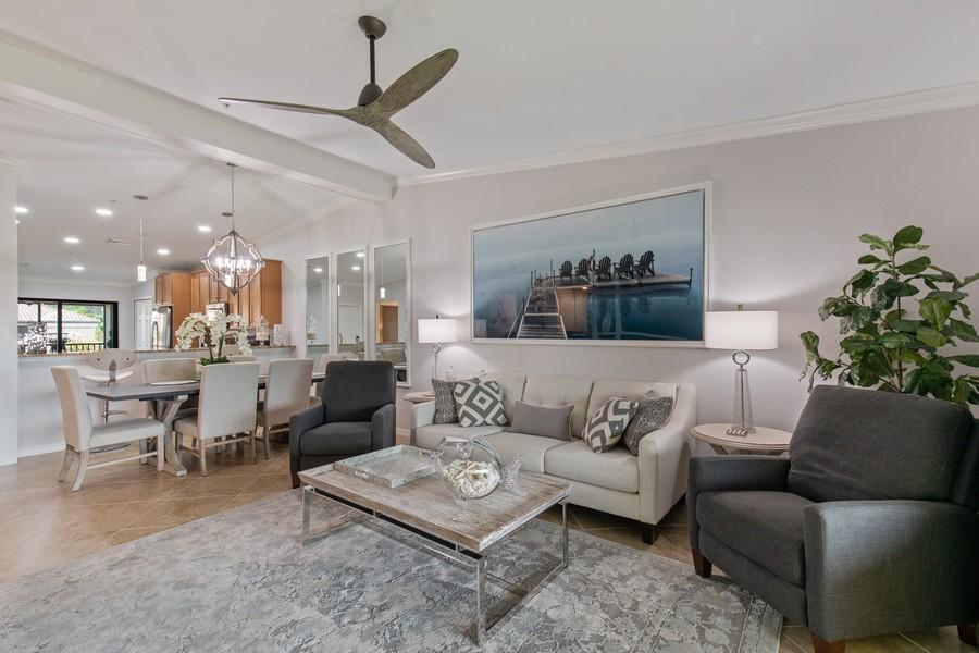 Real Estate Photography - 28022 BRIDGETOWN CT #4825, BONITA SPRINGS, FL, 34135 - Living Room / Dining Room