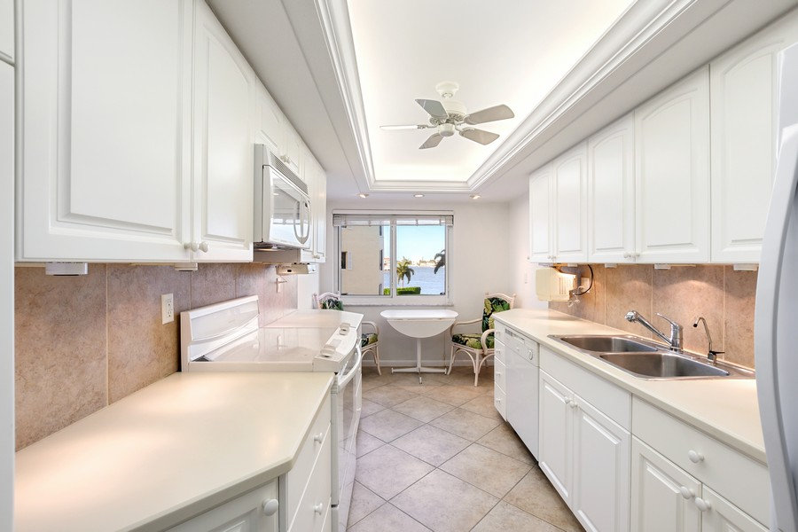 Real Estate Photography - 3410 Gulf Shore Blvd N, 301, Naples, FL, 34103 - Kitchen