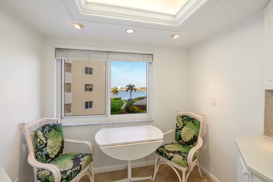 Real Estate Photography - 3410 Gulf Shore Blvd N, 301, Naples, FL, 34103 - Dining Area 2