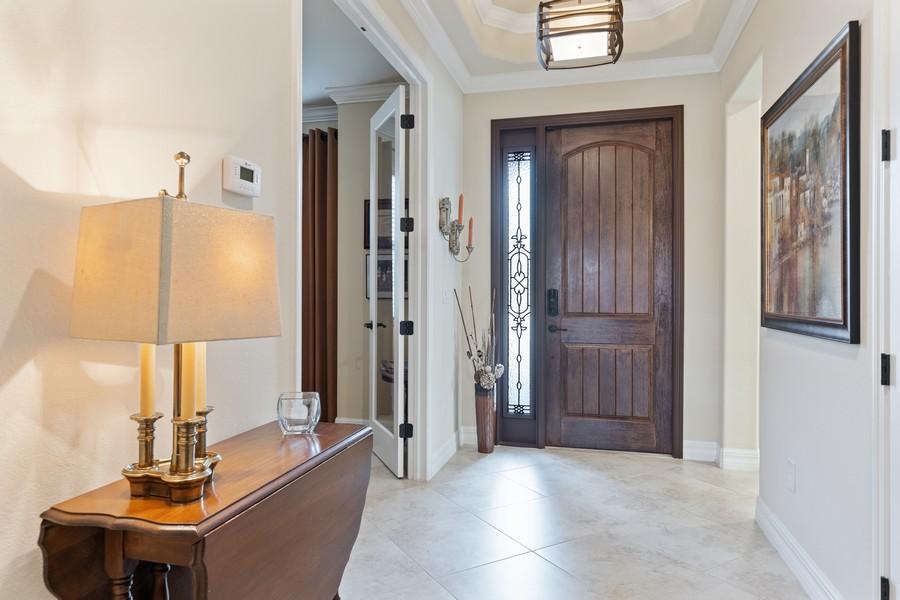Real Estate Photography - 28522 Westmeath Ct, Bonita Springs, FL, 34135 - Foyer