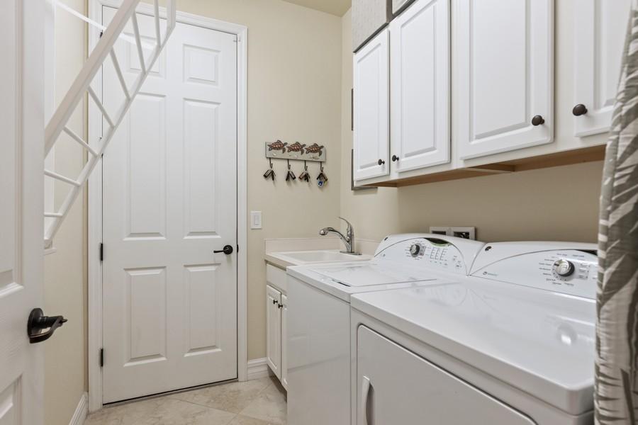 Real Estate Photography - 28522 Westmeath Ct, Bonita Springs, FL, 34135 - Laundry Room