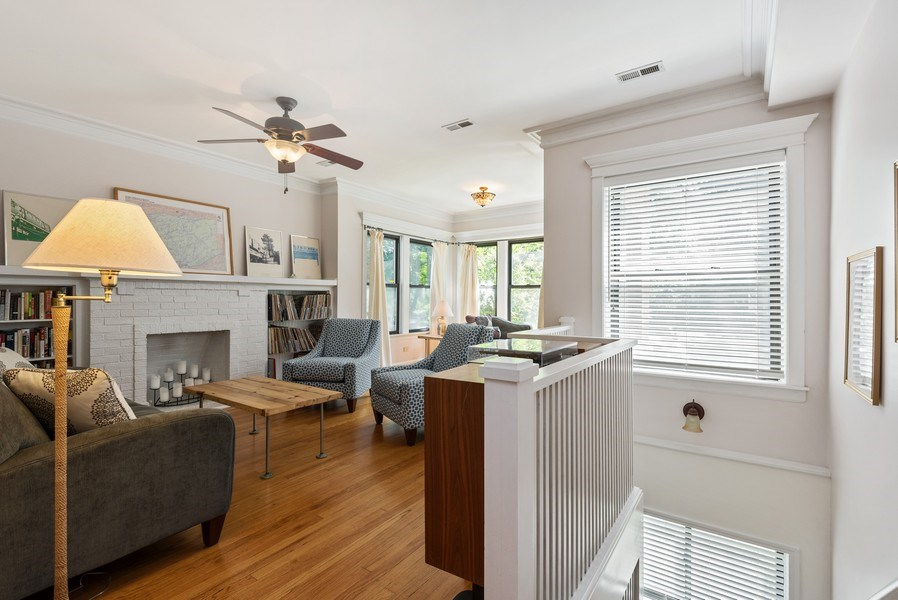 Real Estate Photography - 4822 N Winchester, 1N, Chicago, IL, 60625 - Living Room with east facing windows