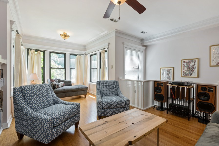 Real Estate Photography - 4822 N Winchester, 1N, Chicago, IL, 60625 - Living Room with crown molding, sun room