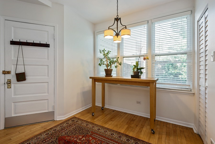 Real Estate Photography - 4822 N Winchester, 1N, Chicago, IL, 60625 - Breakfast Room/ mudroom, tons of storage!