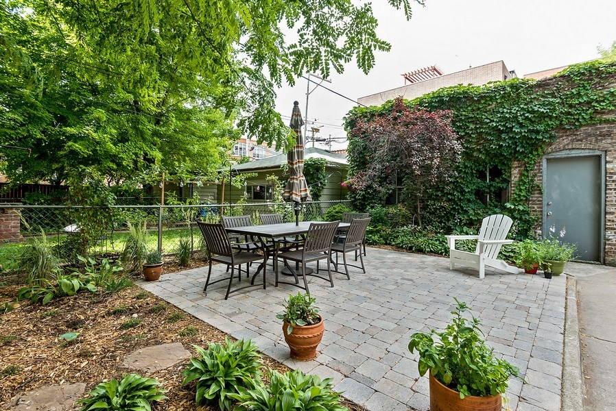 Real Estate Photography - 4822 N Winchester, 1N, Chicago, IL, 60625 - New patio, backyard and garage.