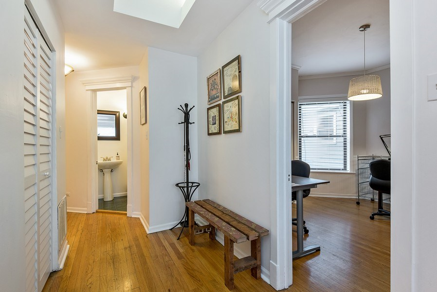 Real Estate Photography - 4822 N Winchester, 1N, Chicago, IL, 60625 - Entry foyer, sitting area, coat closet