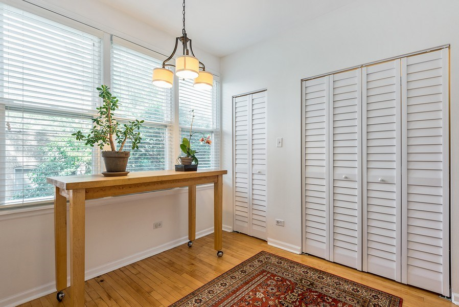 Real Estate Photography - 4822 N Winchester, 1N, Chicago, IL, 60625 - Breakfast area / mudroom off kitchen with tons of